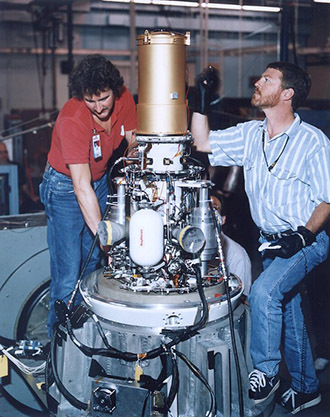This undated file photo released by the Pentagon shows two unidentified workers with the exoatmospheric kill vehicle (EKV), a missile interceptor that is part of an anti-missile defense system. (AFP Photo)