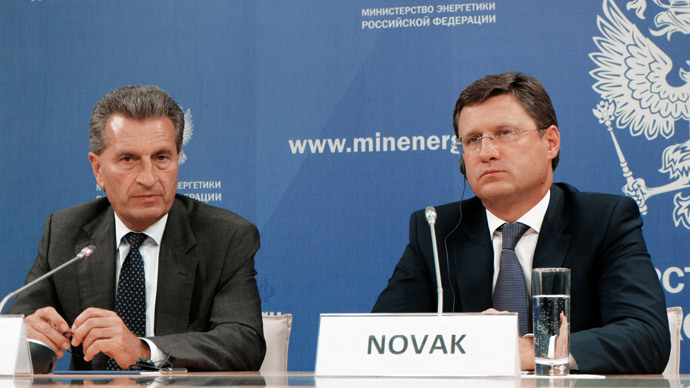 Russian Energy Minister Alexander Novak, right, and European Commissioner for Energy and European Commission Vice-President Gunther Oettinger meet in Moscow.(RIA Novosti)