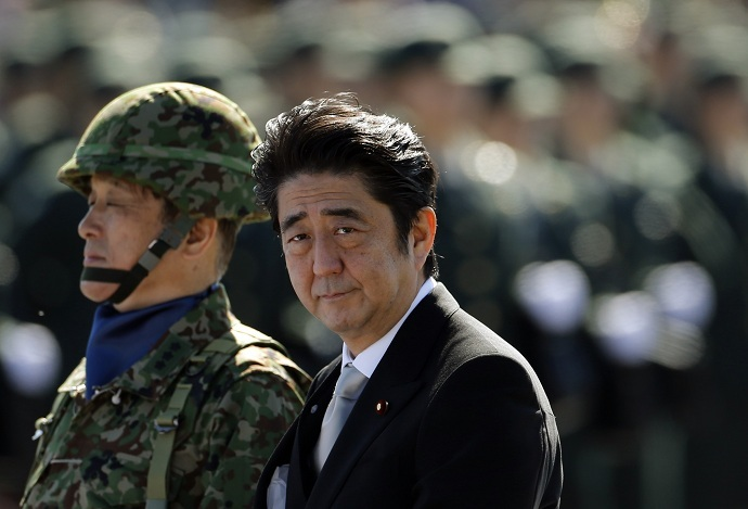 Japanese Prime Minister Shinzo Abe (R) reviews Japanese Self-Defence Forces' (SDF) troops during the annual SDF ceremony at Asaka Base in Asaka, near Tokyo, in this October 27, 2013 file photo. (Reuters//Issei Kato/Files)