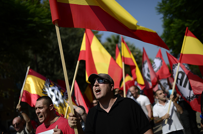 Anti-independence Catalans hold Spanish flags as they take part in a demonstration for the unity of Spain in the centre of Barcelona during Catalonia National Day (Diada) on September 11, 2014. (AFP Photo / Josep Lago)