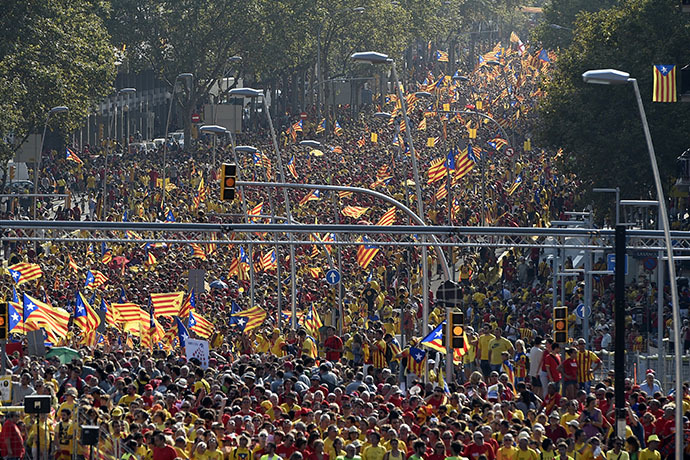 Catalans hold Catalan independentist flags (Estelada) during celebrations of Catalonia National Day (Diada) in Barcelona on September 11, 2014. (AFP Photo / Lluis Gene)