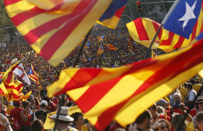 "People hold ""estelada"" flags, Catalan separatist flags, during a gathering to mark the Calatalonia day ""Diada"" in central Barcelona September 11, 2014. (Reuters/Albert Gea)"