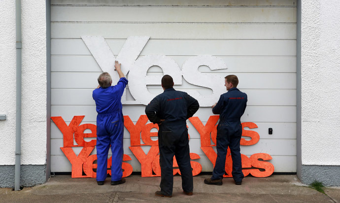 Employees of Gordon diesel services prepare to erect Yes campaign placards on their workshop in Stornoway on the Isle of Lewis in the Outer Hebrides September 11, 2014. (Reuters/Cathal McNaughton)