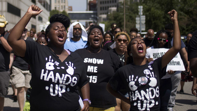 Activists raise their hands as they demand justice for the killing of Michael Brown while marching to the Thomas F. Eagleton United States Courthouse from City Hall in downtown St. Louis, Missouri, August 26, 2014. (Reuters/Adrees Latif)
