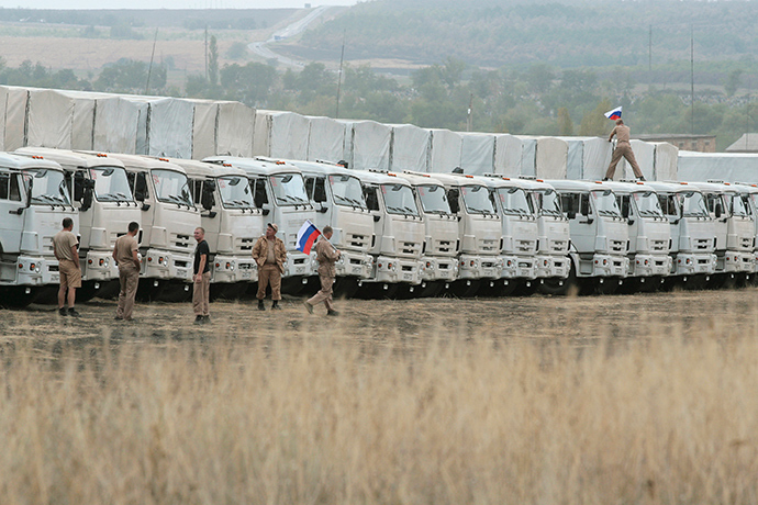 A Russian convoy of trucks carrying humanitarian aid for Ukraine is parked at a camp near Kamensk-Shakhtinsky, Rostov Region, September 12, 2014 (Reuters / Alexey Koverznev)