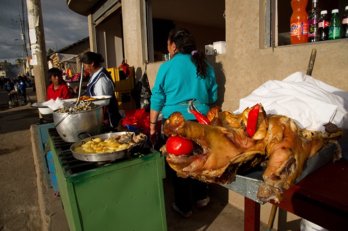 Vendors sell pork and potatoes in San Pedro, Cayambe, some 46 km (28.6 miles) north of Quito (Reuters / Guillermo Granja)