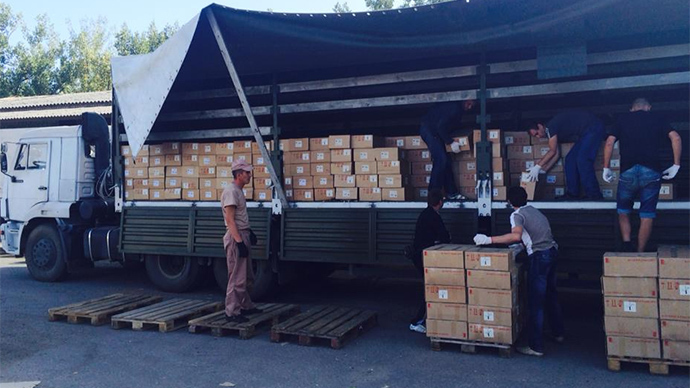 E.Ukraine's Lugansk to start distributing Russian aid Monday, trucks return home