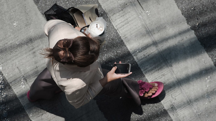 Smartphone separation: Chinese city creates special sidewalk lane for cell phone users