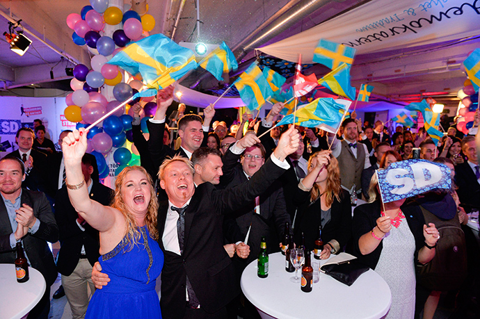 People celebrate at the election night party of the Sweden Democrats, after first exit polls indicated that the party will be the third largest in the Swedish parliament after the Swedish general elections, in Stockholm, September 14, 2014 (Reuters / Anders Wiklund)