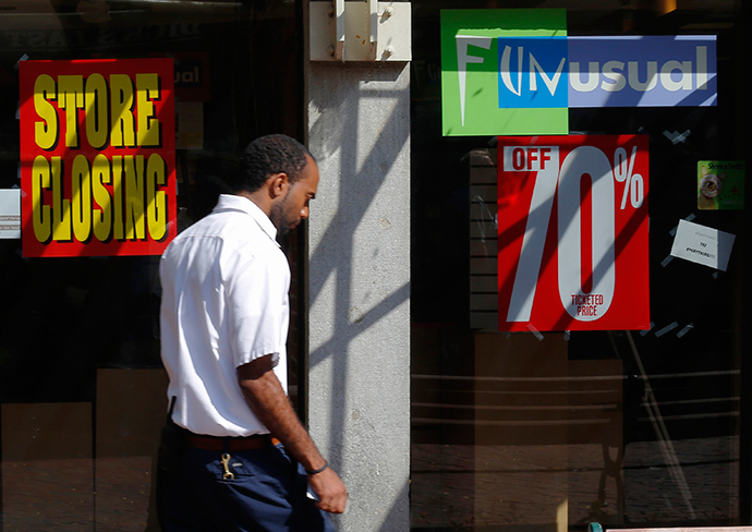 "A man walks past a ""Store Closing"" sign in a shop window at Quincy Market in Boston, Massachusetts September 5, 2014 (Reuters / Brian Snyder)"