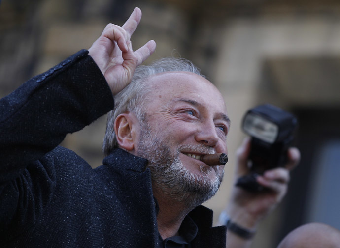 Respect Party candidate George Galloway gestures from an open top bus outside his campaign office in Bradford, northern England, March 30, 2012.(Reuters/Darren Staples)