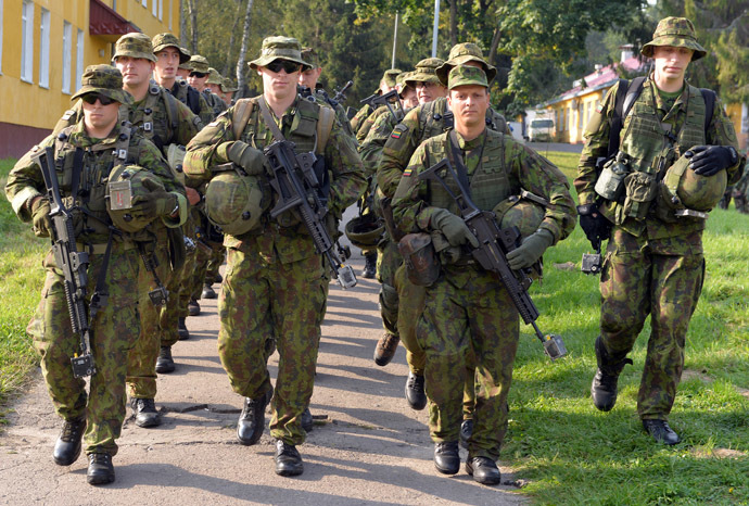 "Lithuanian servicem walk following the opening ceremony of the ""Rapid Trident"" military exercises on September 15, 2014. (AFP Photo/Yurko Dyachyshyn)"