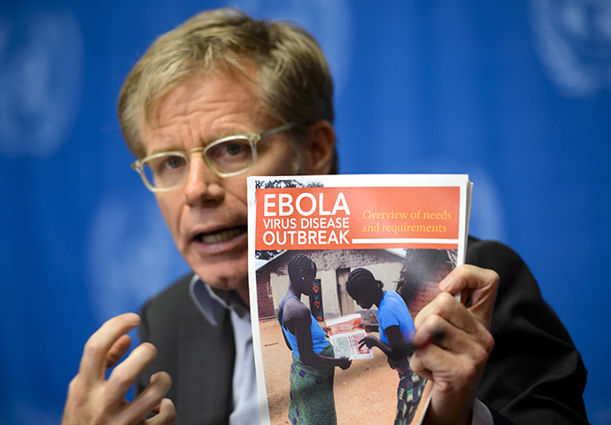 World Health Organization's Assistant Director General Bruce Aylward holds a report on Ebola virus during a press conference on global aid pledged to fight the Ebola outbreak in west Africa on September 16, 2014 at United Nations offices in Geneva. (AFP Photo / Fabrice Coffrini)