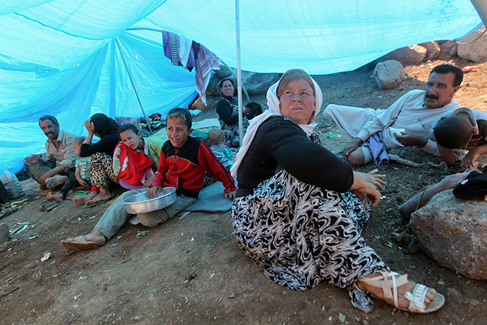 An Iraqi Yazidi refugee family gathers under a tent at Newroz camp in Hasaka province, north eastern Syria after fleeing Islamic State militants in Iraq. (AFP Photo / Ahmad Al-Rubaye)