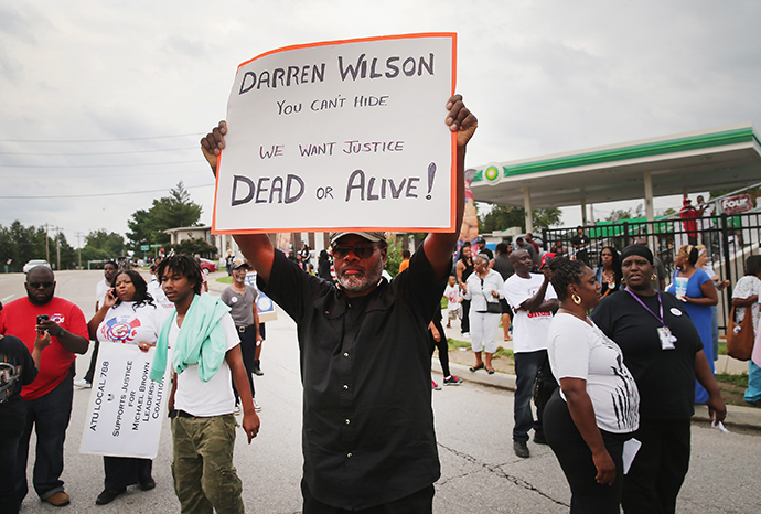 Demonstrators protest near a ramp which leads onto Interstate Highway 70 near Ferguson, Missouri. (Scott Olson / Getty Images / AFP)