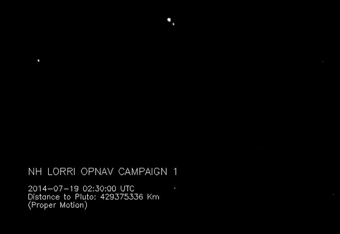 """This """"movie"""" of Pluto and its largest moon, Charon, was taken by NASA's New Horizons spacecraft as it raced toward Pluto in July 2014. (NASA)"""