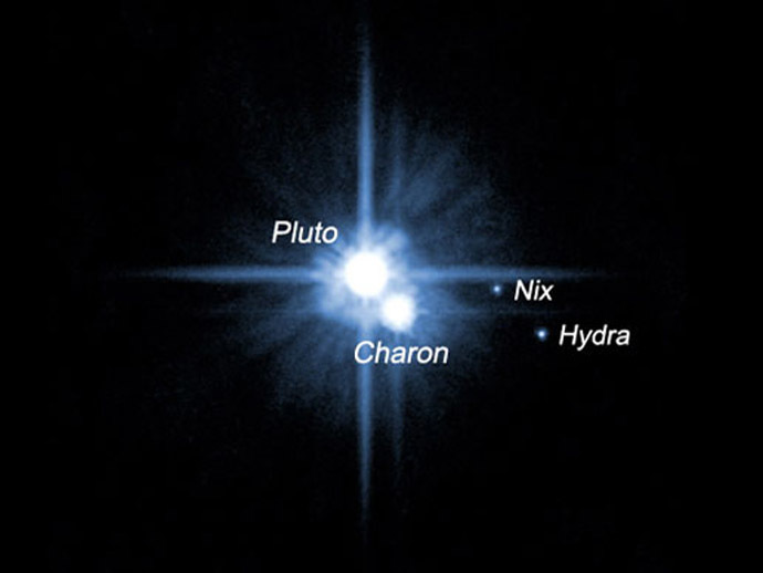 A pair of small moons that NASA's Hubble Space Telescope discovered orbiting Pluto now have official names: Nix and Hydra. Photographed by Hubble in 2005, Nix and Hydra are roughly 5,000 times fainter than Pluto and are about two to three times farther from Pluto than its large moon, Charon, which was discovered in 1978. (NASA/ESA)