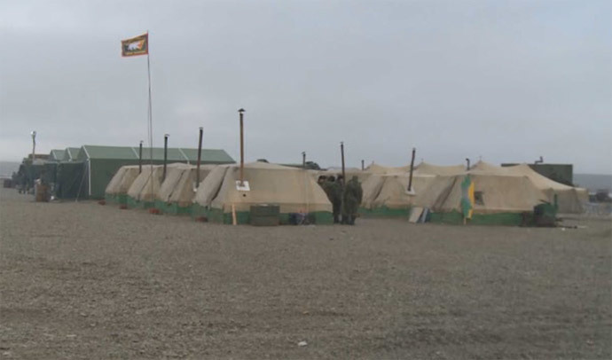 Tents provide temporary housing for the base personnel. Screenshot from RT video