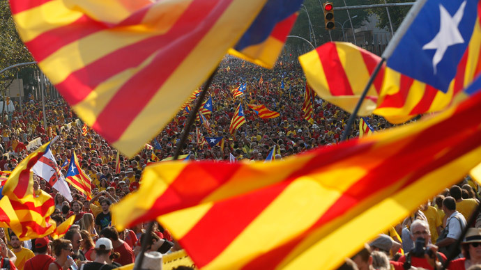 "People hold ""estelada"" flags, Catalan separatist flags, during a gathering to mark the Calatalonia day ""Diada"" in central Barcelona September 11, 2014. (Reuters / Albert Gea)"