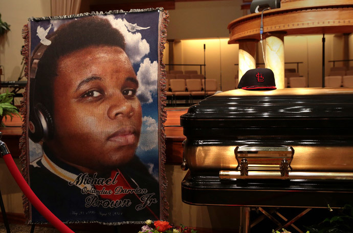 A baseball cap and a portrait of Michael Brown is shown alongside his casket inside Friendly Temple Missionary Baptist Church before the start of funeral services in St. Louis, Missouri (Reuters / Robert Cohen / Pool)