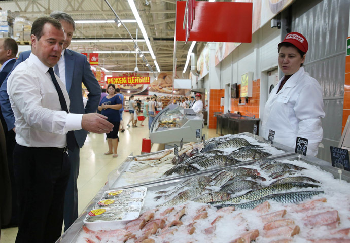 Russian Prime Minister Dmitry Medvedev, left, visits a Magnit supermarket in the town of Korenovsk. (RIA Novosti/Ekaterina Shtukina)
