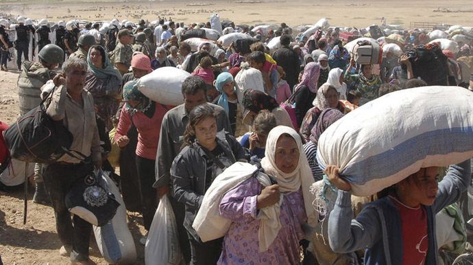 60,000 Syrian Kurds flee to Turkey within 24 hours amid ISIS advance