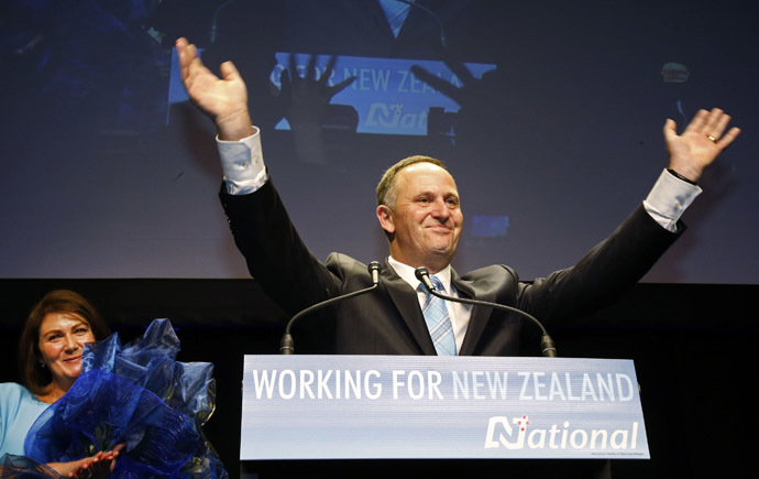 New Zealand's National Party leader and Prime Minister-elect John Key celebrates a landslide victory as his wife Bronagh (L) applauds at the National election party during New Zealand's general election in Auckland, September 20, 2014. (Reuters/Nigel Marple)