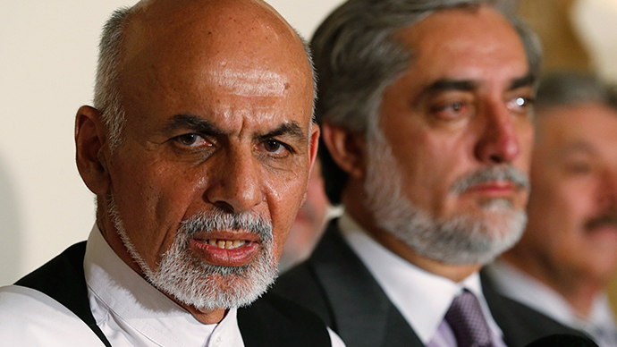 Afghan presidential candidates sign power-sharing deal