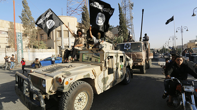 Militant Islamist fighters take part in a military parade along the streets of Syria's northern Raqqa province (Reuters)