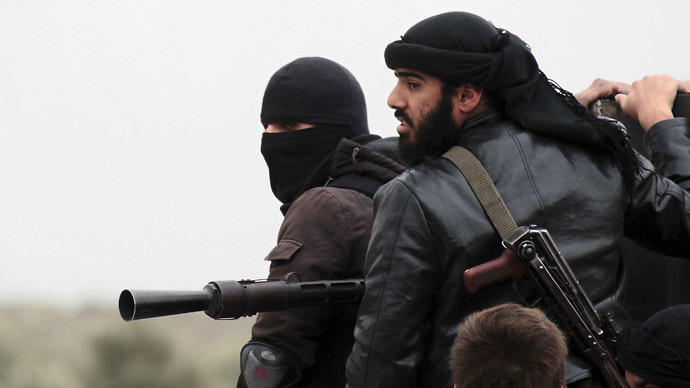 Fighters of the jihadist group Al-Nusra Front stand on the top of a pick-up mounted with a machine gun during fightings against the regime forces on April 4, 2013 in the Syrian village of Aziza, on the southern outskirts of Aleppo. (AFP Photo)