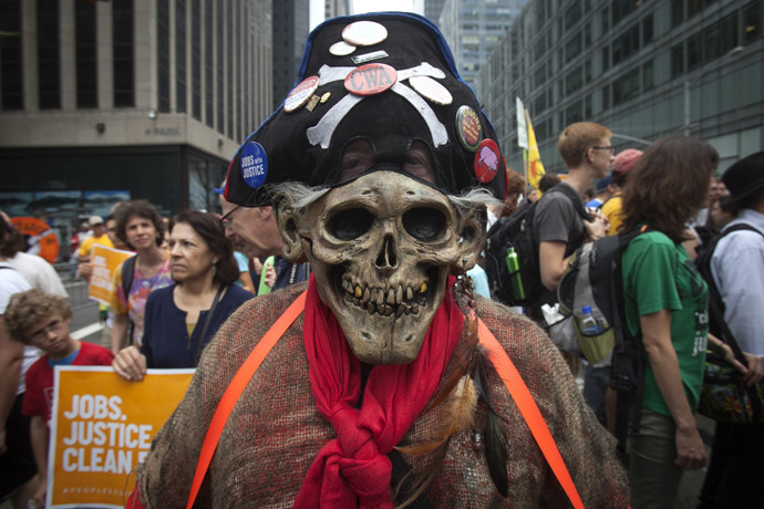 "A protester in a skull mask takes part in the ""People's Climate March"" down 6th Ave in the Manhattan borough of New York September 21, 2014. (Reuters/Carlo Allegri)"
