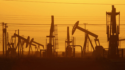 Oil prices edge up after hitting 22-month low
