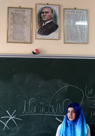 A portrait of the founder of the Turkish Republic, Mustafa Kemal Ataturk, hangs above a blackboard at the Kazim Karabekir Girls' Imam-Hatip School in Istanbul (Reuters / Murad Sezer)