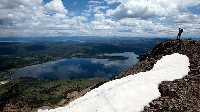 A hiker stands on top of Mount Sheridan, overlooking Heart Lake in the Red Mountains of Yellowstone National Park, Wyoming (Reuters / Lucy Nicholson)