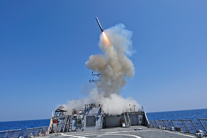 The guided-missile destroyer USS Barry launches a Tomahawk cruise missile from the ship's bow in the Mediterranean Sea in this U.S. Navy handout photo dated March 29, 2011. (Reuters / Jonathan Sunderman / U.S. Navy //Handout)