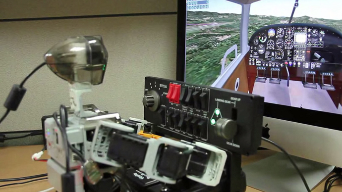 Humanoid pilot: PIBOT, a toy-sized robot, learns how to fly a real plane (VIDEO)