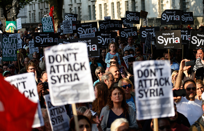 ARCHIVE PHOTO: Protestors listen to speeches during a rally against the proposed attack on Syria in central London August 28, 2013 (Reuters / Olivia Harris)