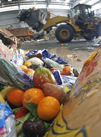 Expired fruits from a supermarket sit on the sorting floor at a recycling center (Reuters/Tim Shaffer)
