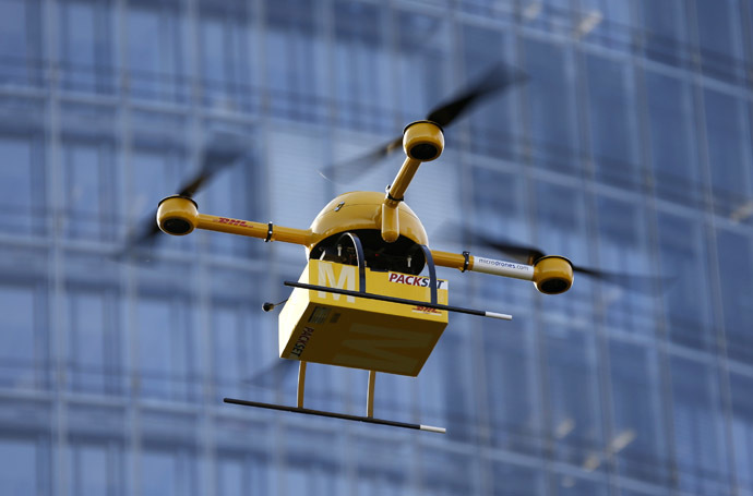 "A prototype ""parcelcopter"" of German postal and logistics group Deutsche Post DHL flies in front of the company's headquarters in Bonn December 9, 2013. (Reuters/Wolfgang Rattay)"