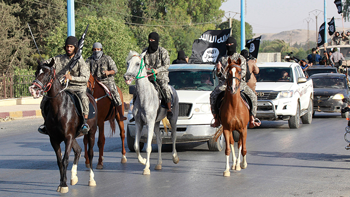 Militant Islamist fighters ride horses as they take part in a military parade along the streets of Syria's northern Raqqa province (Reuters / Stringer)