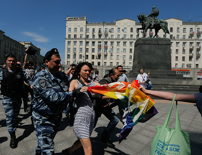 Gay rights activists are detained by police during a protest in Moscow (Reuters / Maxim Shemetov)