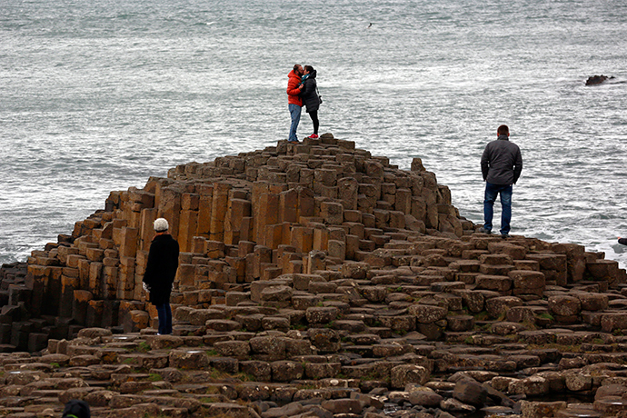 A couple embrace on the rocks at the Giant's Causeway situated on the north coast of Northern Ireland (Reuters / Cathal McNaughton)