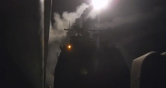 A still image captured from U.S. Navy video footage shows a Tomahawk Land-Attack Missile (TLAM) is launched against ISIL targets from the guided-missile cruiser USS Philippine Sea in the Gulf, September 23, 2014. (Reuters/Abe McNatt/U.S. Navy/Handout)