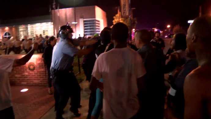 Police officer shot in Ferguson, two suspects at large