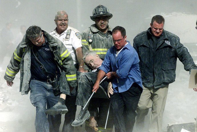 Rescue workers carry fatally injured New York City Fire Depatment Chaplain, Fether Mychal Judge, from one of the World Trade Center towers in New York City, early September 11, 2001. (Reuters/Shannon Stapleton)