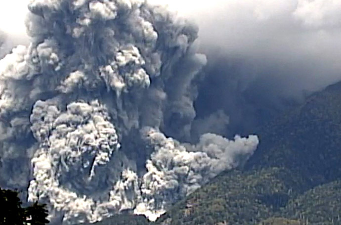This TV picture released by Japan's Ministry of Land, Infrastructure and Transport Chubu Regional Development Bureau on September 27, 2014 shows the eruption of the Mount Ontake in Nagano prefecture on September 27, 2014. (AFP/Jiji Press)