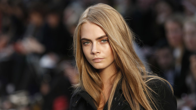 Model Cara Delevingne presents a creation from the Burberry Prorsum Autumn/Winter 2013 collection during London Fashion Week February 18, 2013. (Reuters/Suzanne Plunkett)