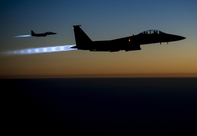 A pair of U.S. Air Force F-15E Strike Eagles fly over northern Iraq after conducting airstrikes in Syria, in this U.S. Air Force handout photo taken early in the morning of September 23, 2014. (Reuters/U.S. Air Force/Senior Airman Matthew Bruch)
