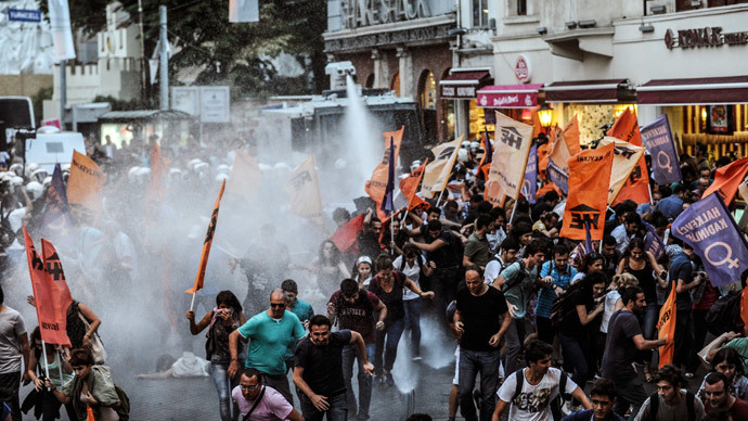 Turkish police use water cannon as they clash with leftist protestors on August 28, 2014, in Istanbul. Leftist groups gathered to protest against new Turkish president Recep Tayyip Erdogan at Istiklal avenue in Istanbul.(AFP Photo / Ozan Kose)