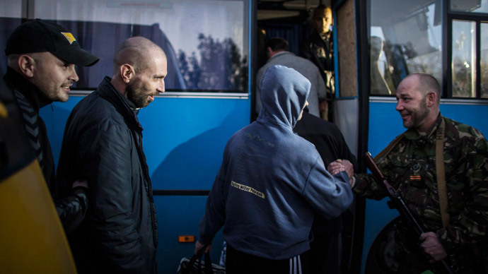 Members of the pro-Russian rebels, who are prisoners-of-war (POWs), enter a bus after being exchanged, north of Donetsk, eastern Ukraine, September 28, 2014.(Reuters / Marko Djurica)
